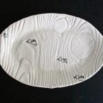 oval bird plate.